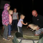 amazing children with a large scale carp