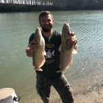 two caught american catfish with catcher