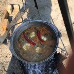 pot with seafood at the boil