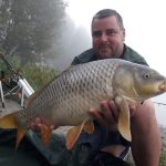 beautiful river carp with angler