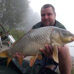 beautiful river carp with angler