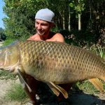 beautiful scale carp with angler summer italien fishing camp serravalle